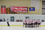 Baldwinsville Bees huddle up before playing the Fayetteville-Manlius Hornets at the Lysander Ice Arena in a Section III Division I Boys Hockey Playoff game at Baldwinsville, New York on Thur ...