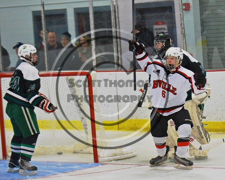 Baldwinsville Bees Josh Racha (6) celebrates his goal against the Fayetteville-Manlius Hornets at the Lysander Ice Arena in a Section III Division I Boys Hockey Playoff game at Baldwinsville, New York on Thursday February 18, 2016.  Baldwinsville won 5-0.