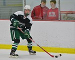 Fayetteville-Manlius Hornets Ben Marschall (15) with the puck against the Baldwinsville Bees at the Lysander Ice Arena in a Section III Division I Boys Hockey Playoff game at Baldwinsville,  ...
