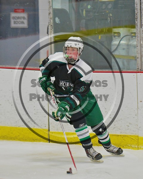 Fayetteville-Manlius Hornets Will Duncanson (5) looking to make a play against the Baldwinsville Bees at the Lysander Ice Arena in a Section III Division I Boys Hockey Playoff game at Baldwinsville, New York on Thursday February 18, 2016.  Baldwinsville won 5-0.