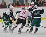 Baldwinsville Bees Alex Paterson-Jones (3) has the puck knocked off his stick by Fayetteville-Manlius Hornets defenders at the Lysander Ice Arena in a Section III Division I Boys Hockey Play ...
