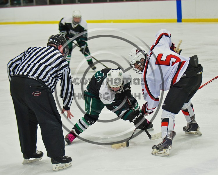 Baldwinsville Bees Isaiah Pompo (5) faces off against Fayetteville-Manlius Hornets Zack Wisby (6) at the Lysander Ice Arena in a Section III Division I Boys Hockey Playoff game at Baldwinsville, New York on Thursday February 18, 2016.  Baldwinsville won 5-0.