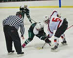 Baldwinsville Bees Isaiah Pompo (5) faces off against Fayetteville-Manlius Hornets Zack Wisby (6) at the Lysander Ice Arena in a Section III Division I Boys Hockey Playoff game at Baldwinsvi ...