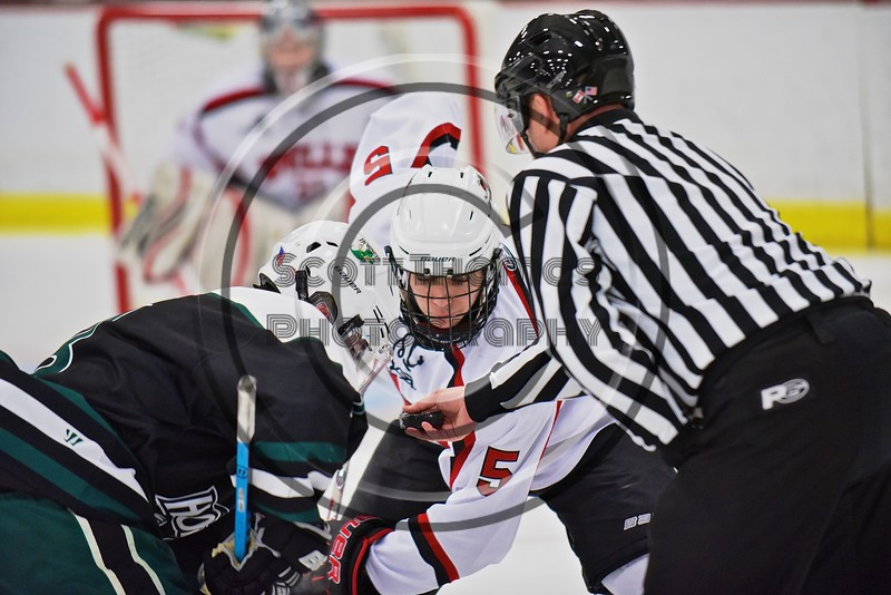 Baldwinsville Bees Isaiah Pompo (5) facing off with a Fayetteville-Manlius Hornets player at the Lysander Ice Arena in a Section III Division I Boys Hockey Playoff game at Baldwinsville, New York on Thursday February 18, 2016.  Baldwinsville won 5-0.