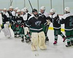 Fayetteville-Manlius Hornets goalie James Kaffenberger (30) being introduced before playing the Baldwinsville Bees at the Lysander Ice Arena in a Section III Division I Boys Hockey Playoff g ...