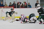 Baldwinsville Bees Garrett Gray (18) gets taken down by Fayetteville-Manlius Hornets Tommy Guilfoil (24) at the Lysander Ice Arena in a Section III Division I Boys Hockey Playoff game at Bal ...
