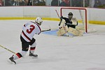 Baldwinsville Bees Alex Paterson-Jones (3) fires the puck at Fayetteville-Manlius Hornets goalie James Kaffenberger (30) at the Lysander Ice Arena in a Section III Division I Boys Hockey Pla ...