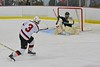 Baldwinsville Bees Alex Paterson-Jones (3) fires the puck at Fayetteville-Manlius Hornets goalie James Kaffenberger (30) at the Lysander Ice Arena in a Section III Division I Boys Hockey Playoff game at Baldwinsville, New York on Thursday February 18, 2016.  Baldwinsville won 5-0.