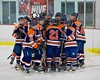 Liverpool Warriors huddle up before playing the Baldwinsville Bees at the Lysander Ice Arena in Baldwinsville, New York on Friday January 22, 2016.
