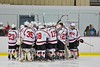 Baldwinsville Bees huddle up before playing the Liverpool Warriors at the Lysander Ice Arena in Baldwinsville, New York on Friday January 22, 2016.