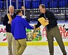West Genesee Wildcats Head Coach Frank Colabufo is congratulated by Section III officials after his team defeated the Baldwinsville Bees for the Section III, Division I Championship in Boys Ice Hockey at the Utica Auditorium on Sunday, February 28, 2016. West Genesee won 1-0.