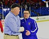 Baldwinsville Bees Head Coach Mark Lloyd congratulates West Genesee Wildcats Head Coach Frank Colabufo for the Wildcats win in the Section III, Division I Championship game in Boys Ice Hockey at the Utica Auditorium on Sunday, February 28, 2016. West Genesee won 1-0.