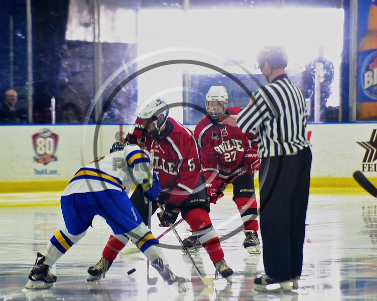 Baldwinsville Bees Isaiah Pompo (5) faces off against West Genesee Wildcats Patrick McDonald (18) to start the third period in the Section III, Division I Championship game in Boys Ice Hockey at the Utica Auditorium on Sunday, February 28, 2016. West Genesee won 1-0.
