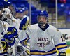 West Genesee Wildcats Daniel Colabufo (15) being introduced before playing the Baldwinsville Bees in the Section III, Division I Championship game in Boys Ice Hockey at the Utica Auditorium on Sunday, February 28, 2016.