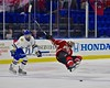 Baldwinsville Bees Alex Paterson-Jones (3) is sent flying by West Genesee Wildcats Conor Bartlett (2) in the Section III, Division I Championship game in Boys Ice Hockey at the Utica Auditorium on Sunday, February 28, 2016. West Genesee won 1-0.