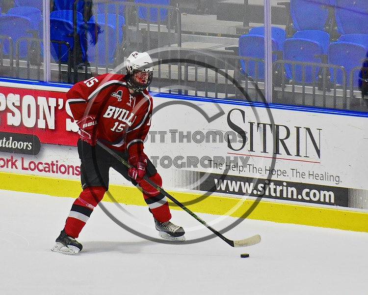 Baldwinsville Bees Charlie Bertrand (15) looking to make a play against the West Genesee Wildcats in the Section III, Division I Championship game in Boys Ice Hockey at the Utica Auditorium on Sunday, February 28, 2016. West Genesee won 1-0.