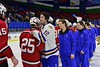 West Genesee Wildcats Matthew McDonald (12) greets Baldwinsville Bees Andrew Starrantino (25) after the Section III, Division I Championship game in Boys Ice Hockey at the Utica Auditorium on Sunday, February 28, 2016. West Genesee won 1-0.