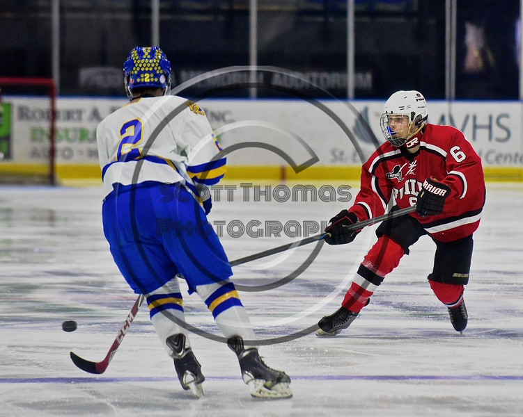 Baldwinsville Bees Josh Racha (6) passes the puck against West Genesee Wildcats Conor Bartlett (2) in the Section III, Division I Championship game in Boys Ice Hockey at the Utica Auditorium on Sunday, February 28, 2016. West Genesee won 1-0.