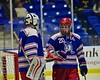 New Hartford Spartans Alec Bard (20) touches gloves with goalie Tyler Hansen (30) before playing the Skaneateles Lakers for the Section III, Division II Championship at the Utica Auditorium on Sunday, February 28, 2016.