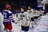 Skaneateles Lakers Matt Leveroni (16) shakes hands with New Hartford Spartans Andrew Mish (21) after winning the Section III, Division II Championship at the Utica Auditorium on Sunday, February 28, 2016. Skaneateles won 4-0.