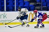 Skaneateles Lakers Sam Clymer (3) with the puck against New Hartford Spartans Andrew Mish (21) in the Section III, Division II Championship game at the Utica Auditorium on Sunday, February 28, 2016. Skaneateles won 4-0.