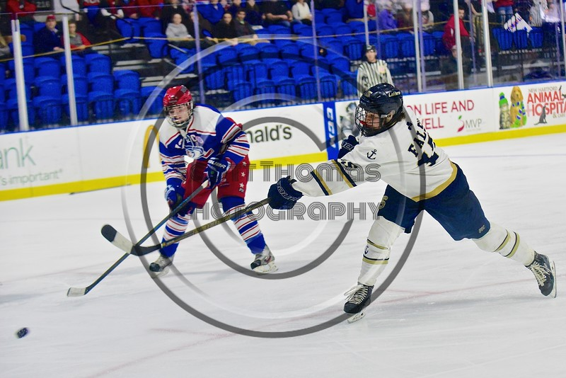 Skaneateles Lakers Ray Falso (15) shoots and scores against the New Hartford Spartans in the Section III, Division II Championship game at the Utica Auditorium on Sunday, February 28, 2016. Skaneateles won 4-0.