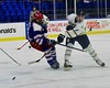 Skaneateles Lakers Reggie Buell (11) gets a shot off with a New Hartford Spartans player defending in the Section III, Division II Championship game at the Utica Auditorium on Sunday, February 28, 2016. Skaneateles won 4-0.