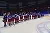 New Hartford Spartans players await the presentation of the Section III, Division II Championship banner to Skaneateles Lakers at the Utica Auditorium on Sunday, February 28, 2016. Skaneateles won 4-0.