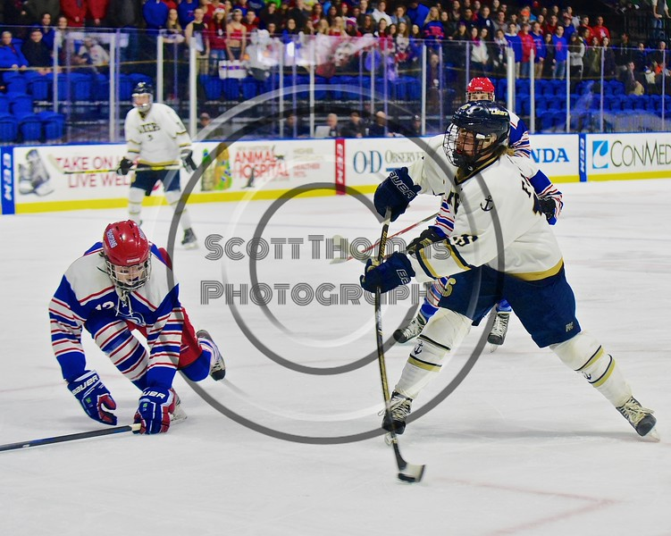 Skaneateles Lakers Ray Falso (15) leans into a shot as New Hartford Spartans Garrett Mahoney (12) goes for a block in the Section III, Division II Championship game at the Utica Auditorium on Sunday, February 28, 2016. Skaneateles won 4-0.