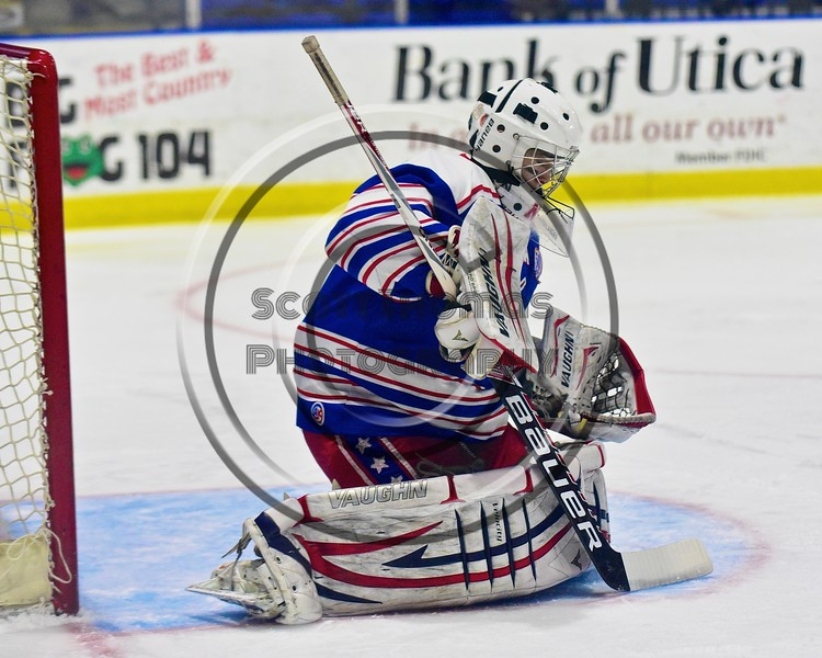 New Hartford Spartans Alec Bard (20) makes a save against the Skaneateles Lakers in the Section III, Division II Championship game at the Utica Auditorium on Sunday, February 28, 2016. Skaneateles won 4-0.