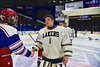 Skaneateles Lakers goalie Bennett Morse (1) shakes hands with a New Hartford Spartans player after winning the Section III, Division II Championship at the Utica Auditorium on Sunday, February 28, 2016. Skaneateles won 4-0.