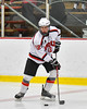 Baldwinsville Bees Connor Carhart (12) looking to make a play against the Liverpool Warriors in NYSPHSAA Section III Boys Ice Hockey action at the Lysander Ice Arena in Baldwinsville, New York on Friday, December 16, 2016. Baldwinsville won 2-0.