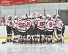Baldwinsville Bees huddle before playing the Liverpool Warriors in NYSPHSAA Section III Boys Ice Hockey action at the Lysander Ice Arena in Baldwinsville, New York on Friday, December 16, 2016.