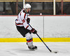 Baldwinsville Bees Zach Perez (26) with the puck against the Liverpool Warriors in NYSPHSAA Section III Boys Ice Hockey action at the Lysander Ice Arena in Baldwinsville, New York on Friday, December 16, 2016. Baldwinsville won 2-0.