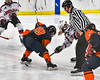 Baldwinsville Bees and Liverpool Warriors face-off to start the game in NYSPHSAA Section III Boys Ice Hockey action at the Lysander Ice Arena in Baldwinsville, New York on Friday, December 16, 2016. Baldwinsville won 2-0.