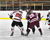 Baldwinsville Bees Zach Perez (26) and Auburn Maroons Jake Morin (28) face-off to start the game in NYSPHSAA Section III Boys Ice Hockey action at the Lysander Ice Arena in Baldwinsville, New York on Tuesday, December 27, 2016. Baldwinsville won 4-3.