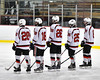 Baldwinsville Bees starting lineup of Ryan Gebhardt (20), Jake DuMond (18), Zach Perez (26), Jamey Natoli (25) and Parker Schroeder (8) before playing the Auburn Maroons in a NYSPHSAA Section III Boys Ice Hockey game at the Lysander Ice Arena in Baldwinsville, New York on Tuesday, December 27, 2016.