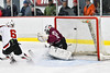 Baldwinsville Bees Ryan Gebhardt (20, not pictured) sends the puck past Auburn Maroons goalie Evan Ryan (30) for the Bees first goal in NYSPHSAA Section III Boys Ice Hockey action at the Lysander Ice Arena in Baldwinsville, New York on Tuesday, December 27, 2016. Baldwinsville won 4-3.