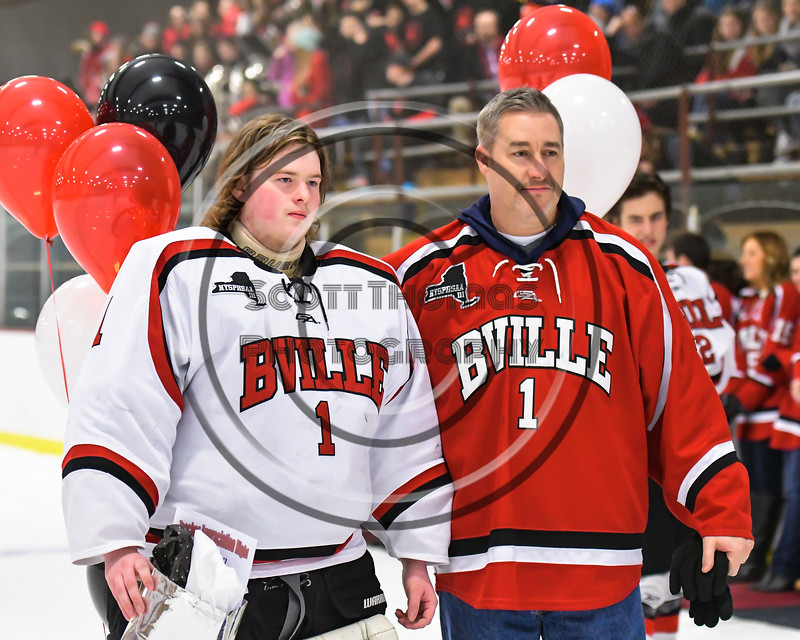 Baldwinsville Bees goalie Josh Smith (1) honors a teacher on Teacher Appreciation Night at the Lysander Ice Arena in Baldwinsville, New York on Friday, January 6, 2017.