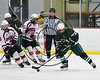 Fayetteville-Manlius Hornets Mike Hockenberger (17) with the puck against the Baldwinsville Bees in NYSPHSAA Section III Boys Ice Hockey action at the Lysander Ice Arena in Baldwinsville, New York on Friday, January 6, 2017. Baldwinsville won 6-0.