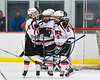 Baldwinsville Bees players Josh Racha (6) and Tanner McCaffrey (2) congratulate Connor Carhart (12) for his goal agianst the Fayetteville-Manlius Hornets in NYSPHSAA Section III Boys Ice Hockey action at the Lysander Ice Arena in Baldwinsville, New York on Friday, January 6, 2017. Baldwinsville won 6-0.