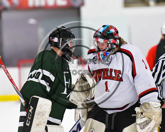 Baldwinsville Bees goalie Josh Smith (1) talked with Fayetteville-Manlius Hornets goalie James Kaffenberger (30) after the NYSPHSAA Section III Boys Ice Hockey game at the Lysander Ice Arena in Baldwinsville, New York on Friday, January 6, 2017. Baldwinsville won 6-0.