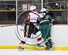 Baldwinsville Bees Jake DuMond (18) checks Fayetteville-Manlius Hornets Will Duncanson (2) in NYSPHSAA Section III Boys Ice Hockey action at the Lysander Ice Arena in Baldwinsville, New York on Friday, January 6, 2017. Baldwinsville won 6-0.