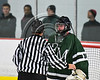 Referee talks with Fayetteville-Manlius Hornets goalie James Kaffenberger (30) in NYSPHSAA Section III Boys Ice Hockey action at the Lysander Ice Arena in Baldwinsville, New York on Friday, January 6, 2017.