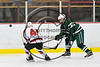 Baldwinsville Bees Shane Sweeney (44) checks the puck away from Fayetteville-Manlius Hornets Mike Hockenberger (17) in NYSPHSAA Section III Boys Ice Hockey action at the Lysander Ice Arena in Baldwinsville, New York on Friday, January 6, 2017. Baldwinsville won 6-0.