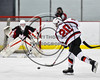 Baldwinsville Bees Ryan Gebhardt (20) fires the puck at the Mohawk Valley Raiders net in NYSPHSAA Section III Boys Ice Hockey action at the Lysander Ice Arena in Baldwinsville, New York on Tuesday, February 7, 2017. Baldwinsville won 1-0.