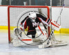 Mohawk Valley Raiders goalie Mike Eastman (1) maks a save against the Baldwinsville Bees in NYSPHSAA Section III Boys Ice Hockey action at the Lysander Ice Arena in Baldwinsville, New York on Tuesday, February 7, 2017. Baldwinsville won 1-0.