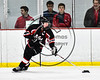 Mohawk Valley Raiders Henry Froass (6) with the puck against the Baldwinsville Bees in NYSPHSAA Section III Boys Ice Hockey action at the Lysander Ice Arena in Baldwinsville, New York on Tuesday, February 7, 2017. Baldwinsville won 1-0.