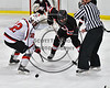 Baldwinsville Bees Connor Carhart (12) facing off against Mohawk Valley Raiders Henry Froass (6) in NYSPHSAA Section III Boys Ice Hockey action at the Lysander Ice Arena in Baldwinsville, New York on Tuesday, February 7, 2017. Baldwinsville won 1-0.