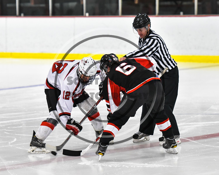 Baldwinsville Bees Connor Carhart (12) faces off against Mohawk Valley Raiders Henry Froass (6) in NYSPHSAA Section III Boys Ice Hockey action at the Lysander Ice Arena in Baldwinsville, New York on Tuesday, February 7, 2017. Baldwinsville won 1-0.